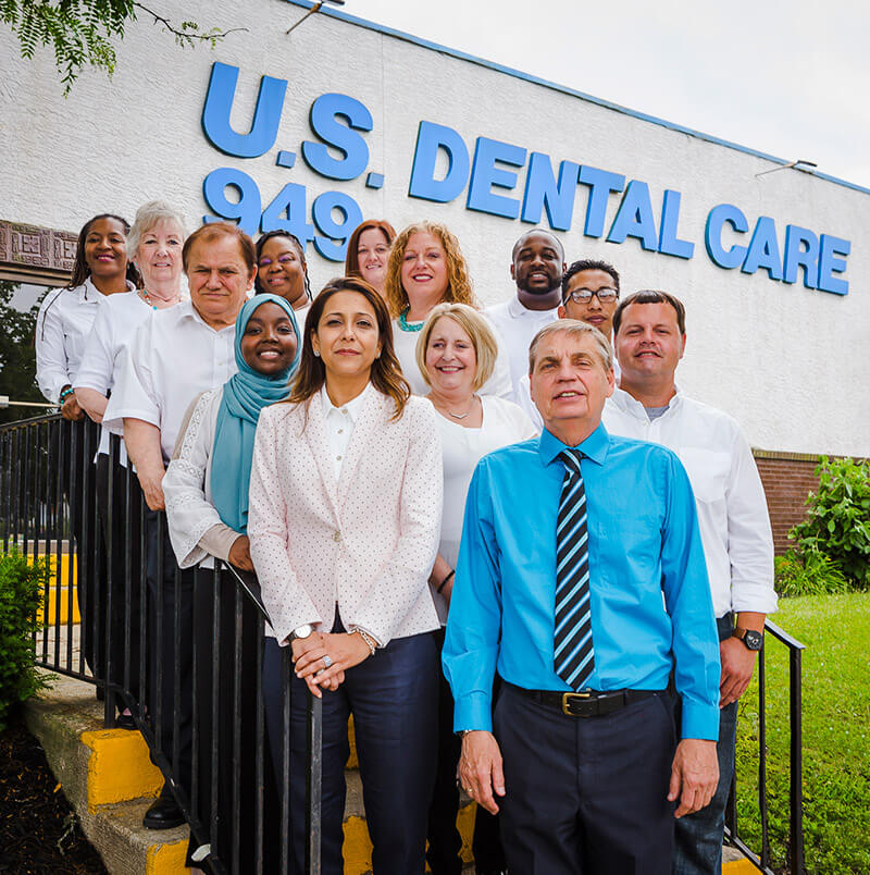 The team standing in front of the US Dental office.