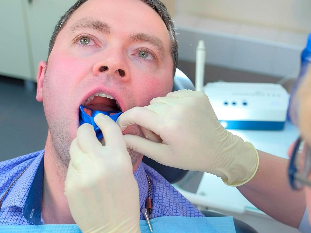 Man Recieving A Fluoride Treatment in Columbus, OH
