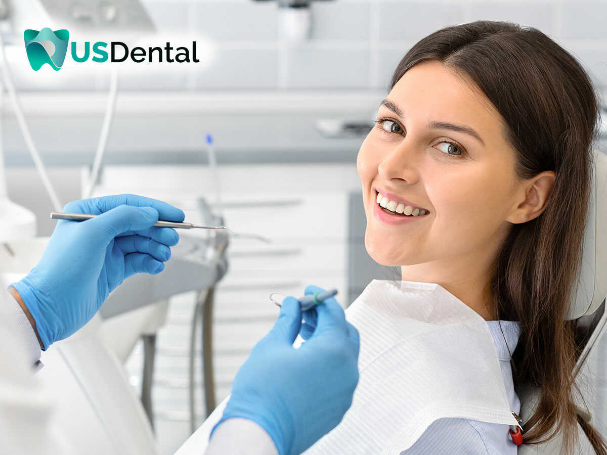 A beautiful woman having her dental crowns check-up by a dentist in Columbus, OH.